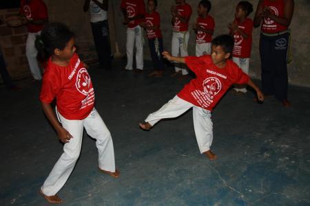 Two children fight in a Capoeira Roda in Imbassai