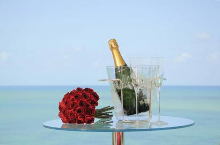 After a wedding in Brazil: Champagne and roses on the beach.