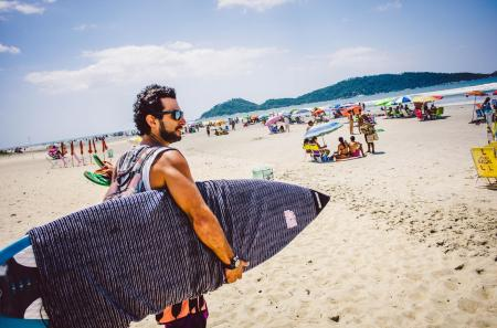 Surfers on the beach of Campeche in Florianopolis