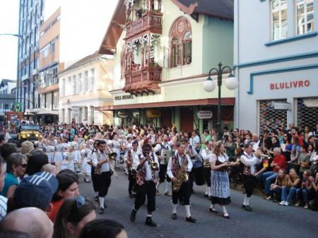 Festive Oktoberfest parade in traditional costumes in Blumenau