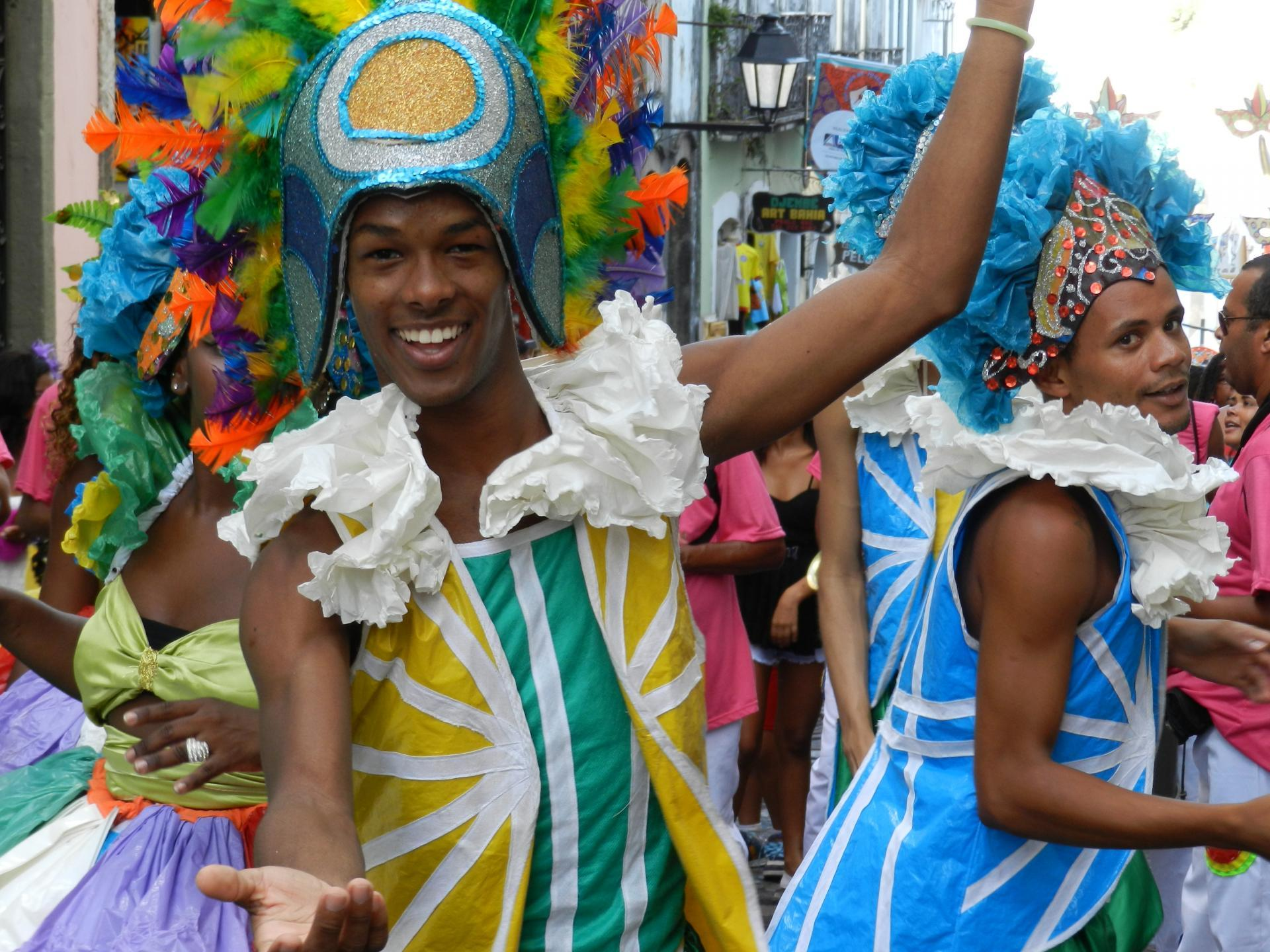 Two men show off wide smiles at Carnival in Salvador, Bahia.