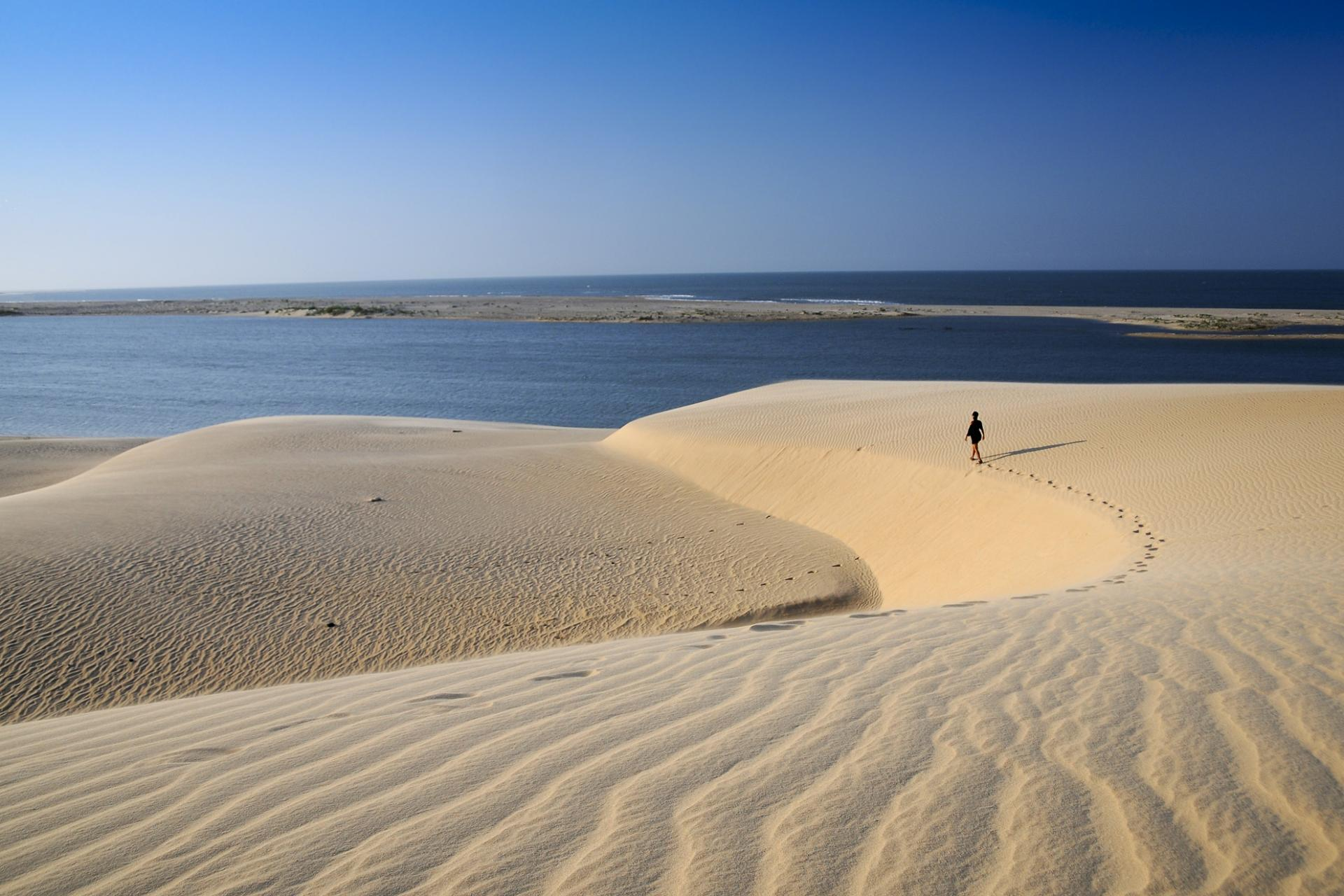 Eco-tourist enjoying the dunes of Lencois Maranhenses