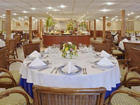 Restaurant with dinning tables on board of Iberostar Grand Amazon