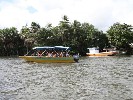 By boat across the Rio Preguicas to Cabure