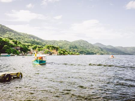 Colorful small boats heading for a day trip around the coast of Florianopolis