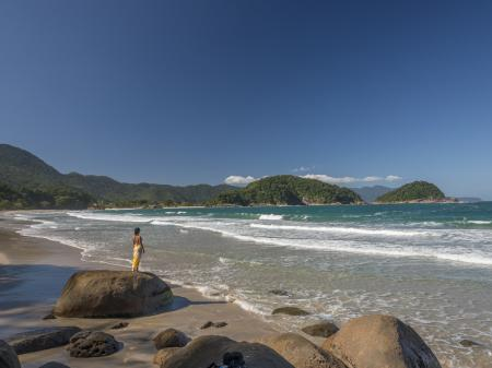 A visitor enjoying the lonely beach near to Paraty