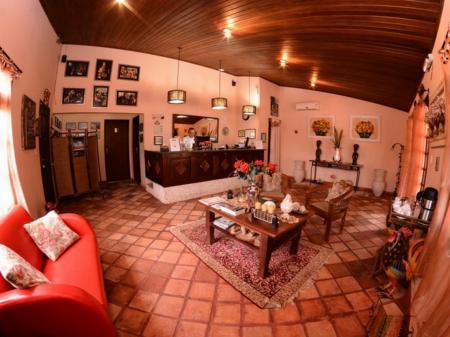 Cozy reception with sofas at Pousada Encantes do Nordeste