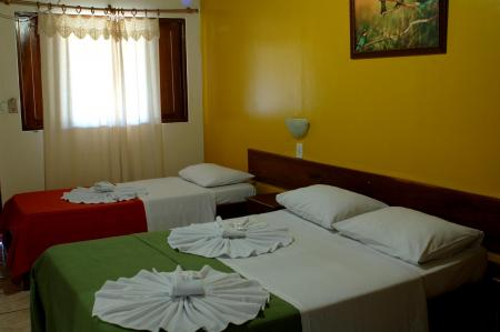 Pousada Piuval - A cozy room with a double bed and a single bed