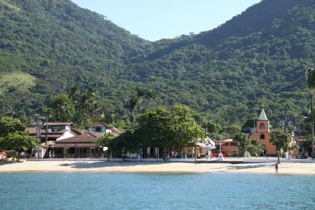 View from the sea to the village of Vila do Abraao on the Ilha Grande