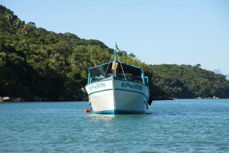 Boat on the sea in front of the Ilha Grande