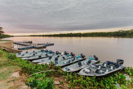 Boats on the river at Santa Rosa Lodge in the northern Pantanal, Brazil