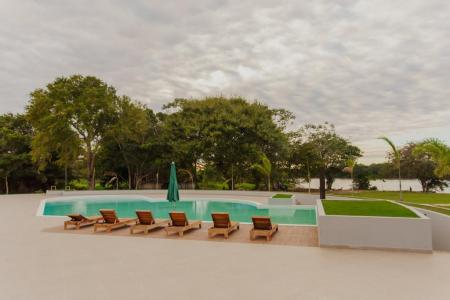 Seats at the modern pool area at Santa Rosa Lodge in the northern Pantanal, Brazil