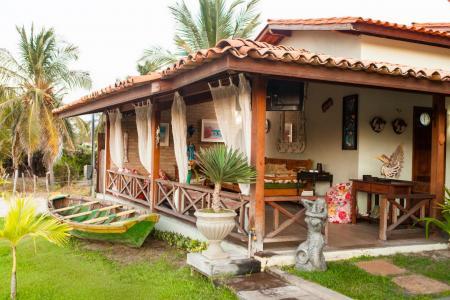 View on the green garden with palm trees of Pousada Jurara