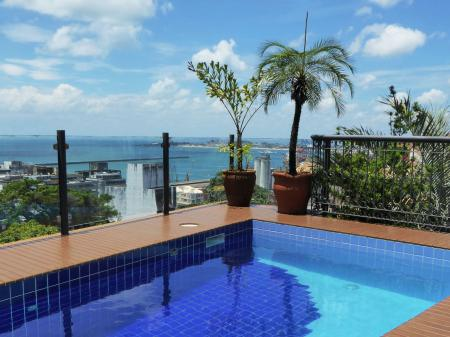 The pool with view over the city of Salvador and the sea, from Hotel Casa do Amarelindo