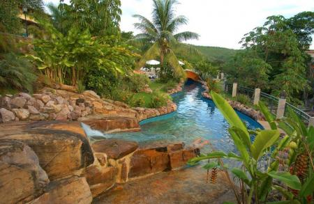 Natural pool with palm trees at Hotel Cantos das Aguas