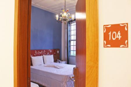 Receptionwith red sofas at Pousada Pai Thomaz in Cachoeira, Bahia - Brazil