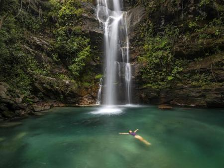 Waterfall fills lagoon for bathing in the Chapada dos Veadeiros