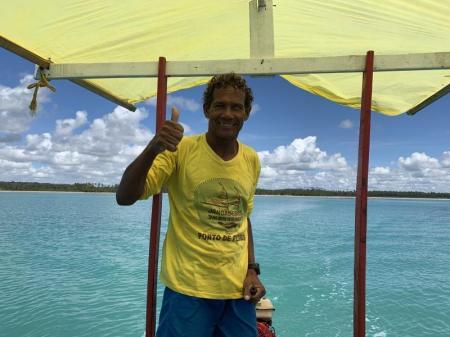 Tourguide on a covered boat in the sea of Praia da Lage