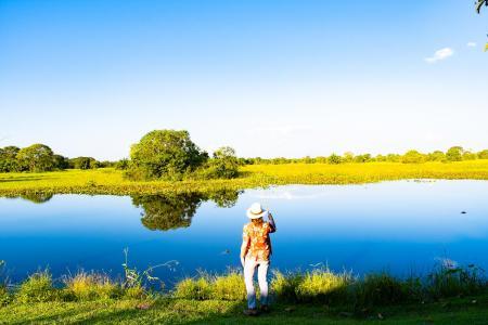 Visitors enjoying the river view at Pousada Aguape