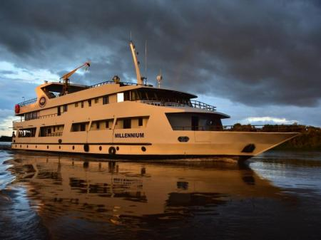 Yacht Millenium at sunset on excursion cruise in the Pantanal