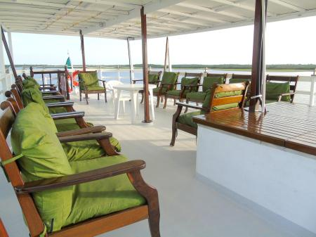 Comfortable chairs on the sun deck of motor yacht Tucano